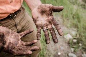 Wipes for farmers Hands man with mud