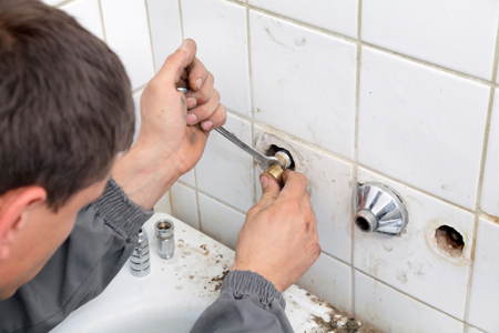 Heating installers plumbers fixing faucet needs Big Wipes cleaning wipes